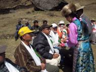 Locals offering traditional drinks Chang at the Welcome Ceremony