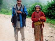 Man and woman from Phaplu heading to the weekly market at Salleri to sell a chicken.